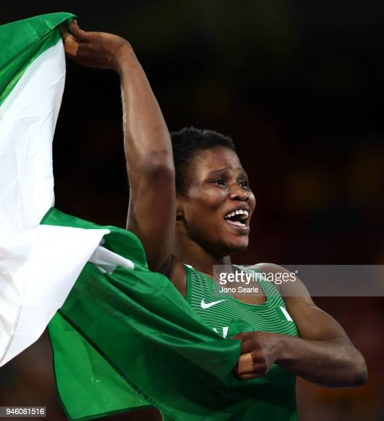 Aminat Adeniyi of Nigeria celebrates winning against Michelle Fazzari of Canada in the women's 62kg Nordic round during Wrestling on day 10 of the...