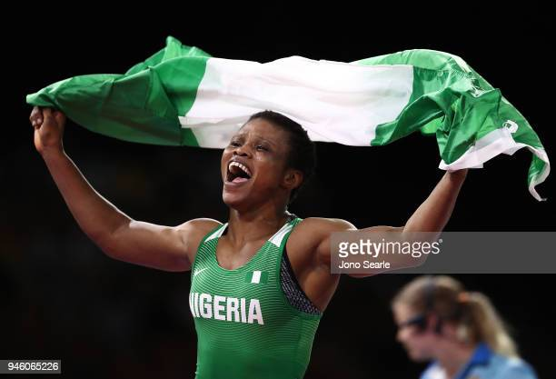 Aminat Adeniyi of Nigeria celebrates winning gold against Michelle Fazzari of Canada in the women's 62kg Nordic round during Wrestling on day 10 of...