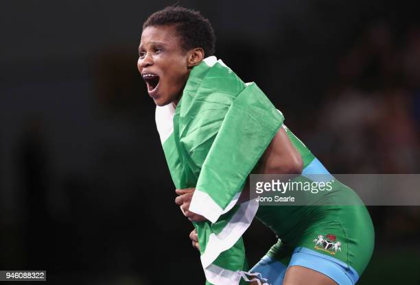 Aminat Adeniyi of Nigeria celebrates winning gold against Michelle Fazzari of Canada in the women's freestyle 62kg event during Wrestling on day 10...