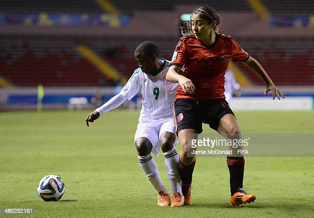 Aminat Yakubu of Nigeria battles with Gabriela Martinez of Mexico during the FIFA U17 Women's World Cup Group D match between Nigeria and Mexico at...
