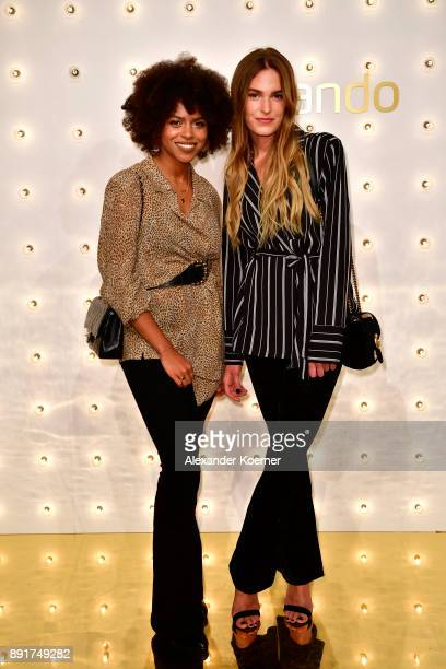 Aminata Belli and Hannah Liza attend the Zalando xmas bash hosted by Alek Wek at Haus Ungarn on December 13 2017 in Berlin Germany