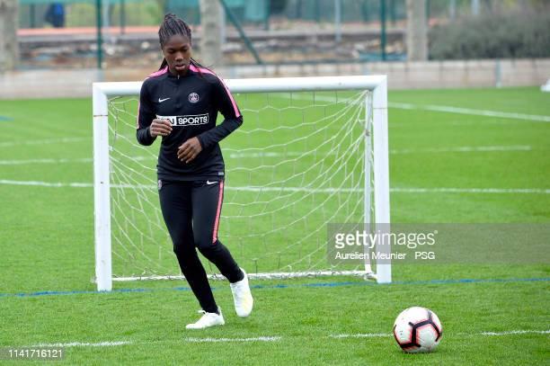 Aminata Diallo runs with the ball during a Paris SaintGermain Women training session on April 10 2019 in Paris France