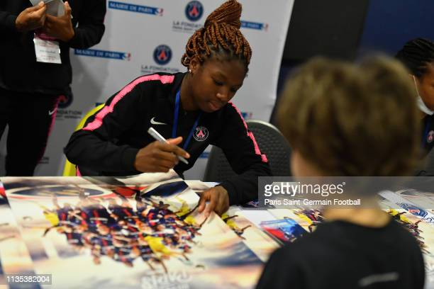 Aminata Diallo signs autograph at Necker Hospital on March 12 2019 in Paris France
