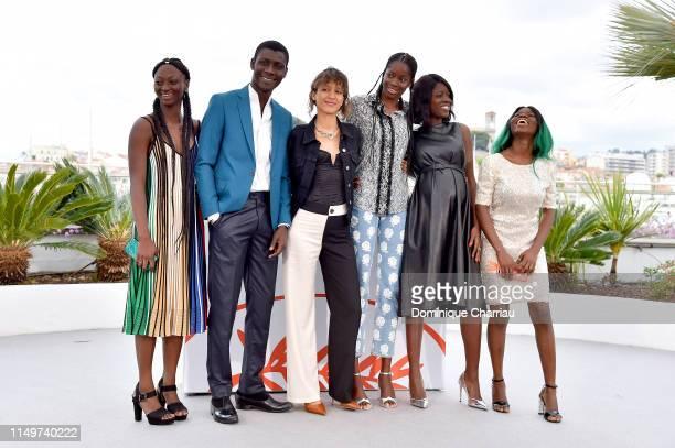 Aminata Kane Amadou Mbow Mati Diop Mame Sane Nicole Sougou and Mariama Gassama attend the Atlantics Photocall during the 72nd annual Cannes Film...
