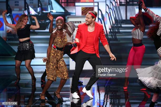 Aminata Sanogo and Marc Eggers perform on stage during the 1st show of the television competition 'Dance Dance Dance' on July 12 2017 in Cologne...