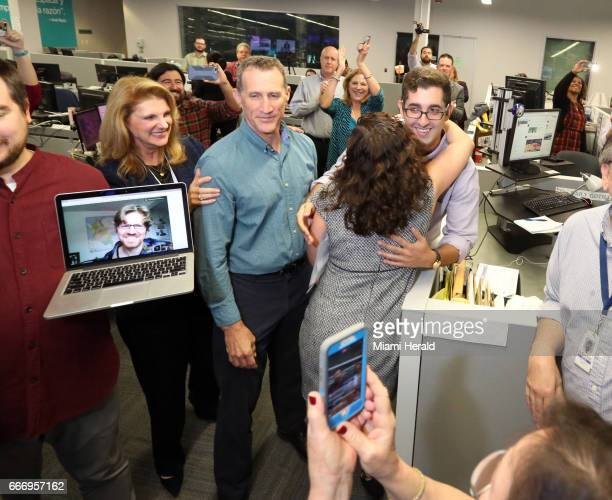 Aminda Marques Gonzalez the Miami Herald's executive editor and vice president hugs Nicholas Nehamas after the announcement of the Panama Papers...