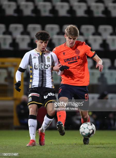 Amine Benchaib of Charleroi battles for the ball with Charles De Ketelaere of Club Brugge during the Jupiler Pro League match between Sporting de...