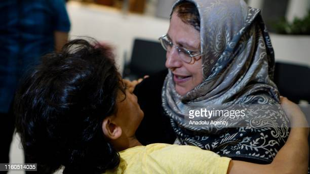 Amine el Mulhim , a partially-sighted woman, meets her children after being released from Adra Prison in Damascus on August 09, 2019 in Istanbul,...