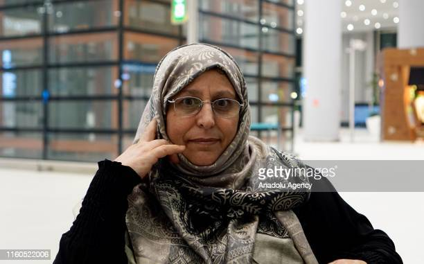 Amine el Mulhim , a partially-sighted woman, speaks to media after meeting her children following her release from Adra Prison in Damascus on August...