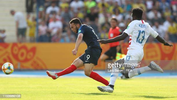 Amine Gouiri of France scores his team's first goal during the 2019 FIFA U20 World Cup Round of 16 match between France and USA at Bydgoszcz Stadium...