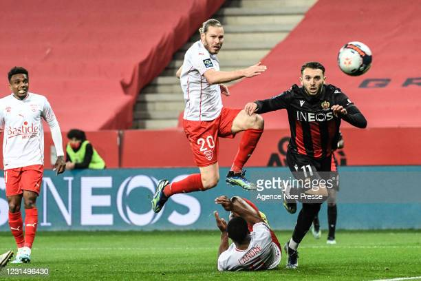 Amine GOUIRI of Nice and Renaud RIPART of Nimes during the Ligue 1 match between OGC Nice and Nimes Olympique at Allianz Riviera on March 7, 2021 in...