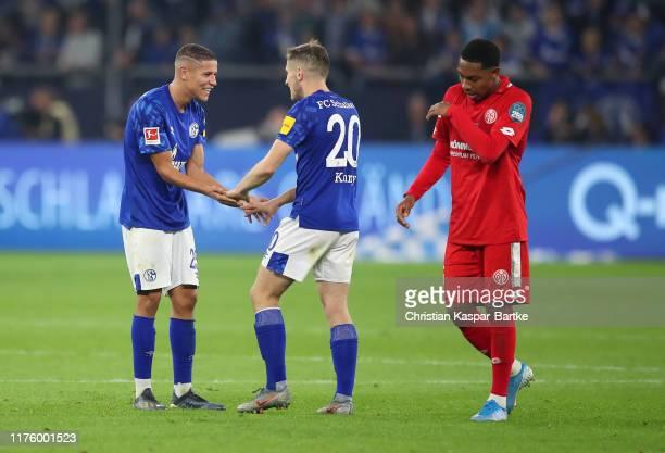 Amine Harit and Jonjoe Kenny of FC Schalke 04 celebrate victory after the Bundesliga match between FC Schalke 04 and 1 FSV Mainz 05 at VeltinsArena...