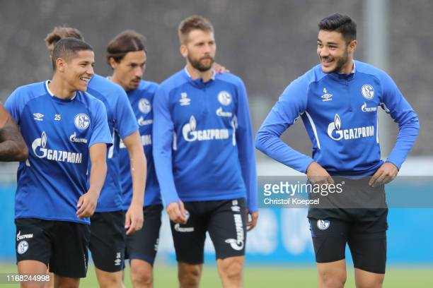 Amine Harit and Ozan Kabak smile during the training session of FC Schalke at Training Ground on August 15 2019 in Gelsenkirchen Germany
