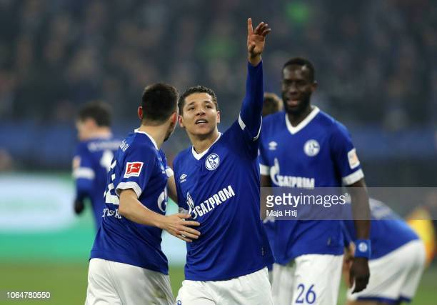 Amine Harit celebrates with teammates after scoring his team's second goal during the Bundesliga match between FC Schalke 04 and 1 FC Nuernberg at...