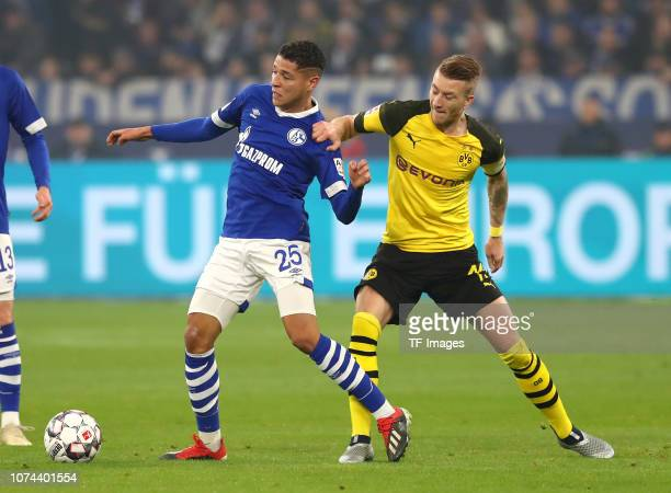 Amine Harit of FC Schalke 04 and Marco Reus of Borussia Dortmund battle for the ball during the Bundesliga match between FC Schalke 04 and Borussia...