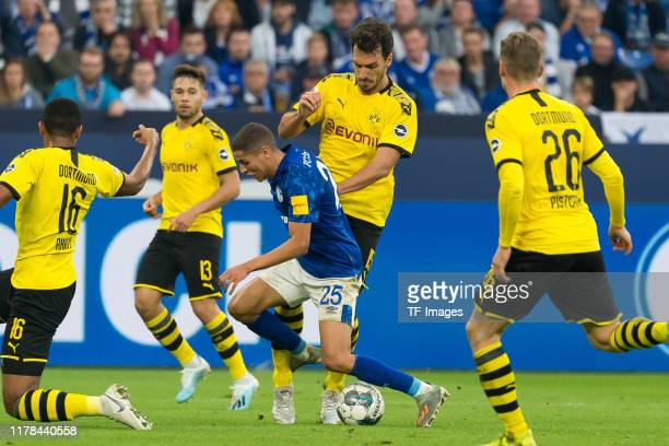 Amine Harit of FC Schalke 04 and Mats Hummels of Borussia Dortmund battle for the ball during the Bundesliga match between FC Schalke 04 and Borussia...