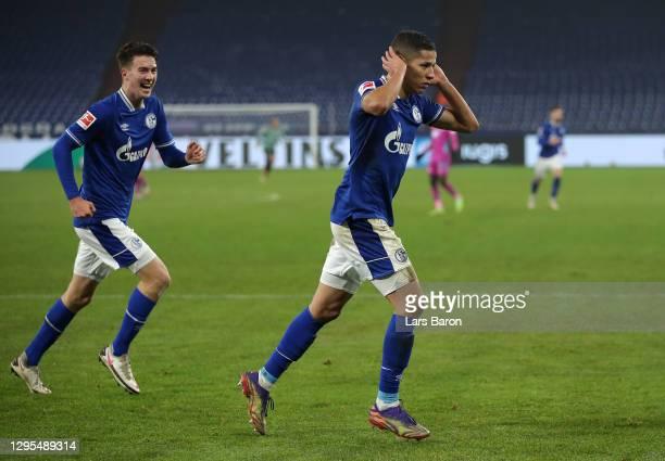 Amine Harit of FC Schalke 04 celebrates after scoring their team's fourth goal during the Bundesliga match between FC Schalke 04 and TSG Hoffenheim...