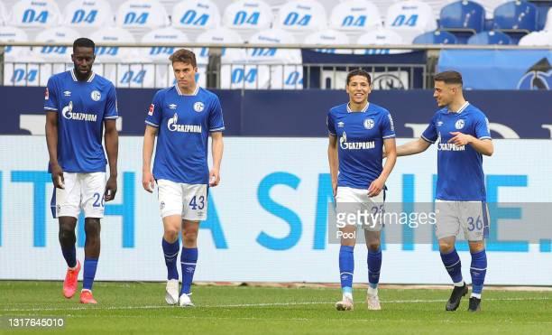 Amine Harit of FC Schalke 04 celebrates with Salif Sane, Matthew Hoppe and Blendi Idrizi after scoring their side's first goal during the Bundesliga...