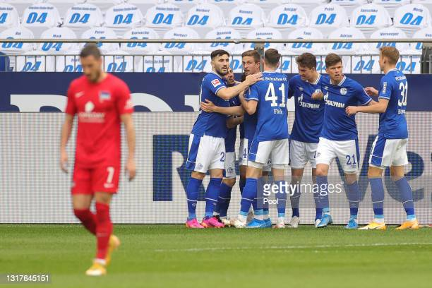 Amine Harit of FC Schalke 04 celebrates with team mates after scoring their side's first goal during the Bundesliga match between FC Schalke 04 and...