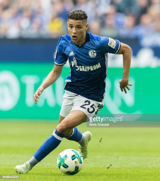 Amine Harit of FC Schalke 04 runs with the ball during the Bundesliga match between FC Schalke 04 and Borussia Dortmund at VeltinsArena on April 15...