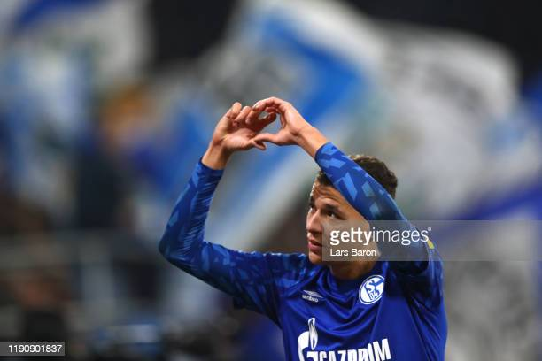 Amine Harit of FC Schalke 04 salutes the fans as he is substituted during the Bundesliga match between FC Schalke 04 and 1. FC Union Berlin at...