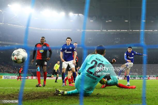 Amine Harit of FC Schalke 04 scores his team's second goal past Rune Jarstein of Hertha BSC during the DFB Cup round of sixteen match between FC...