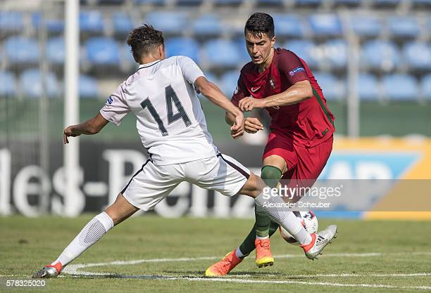 Amine Harit of France challenges Pedro Rodrigues of Portugal during the U19 match between Portugal and France at CarlBenzStadium on July 21 2016 in...