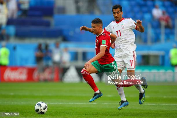 Amine Harit of Morocco and Vahid Amiri of IR Iran during the 2018 FIFA World Cup Russia group B match between Morocco and Iran at Saint Petersburg...