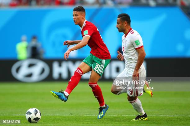 Amine Harit of Morocco competes with Omid Ebrahimi of IR Iran during the 2018 FIFA World Cup Russia group B match between Morocco and Iran at Saint...