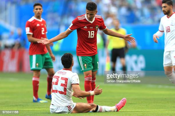 Amine Harit of Morocco has words with Ramin Rezaeian of Iran during the 2018 FIFA World Cup Russia group B match between Morocco and Iran at Saint...