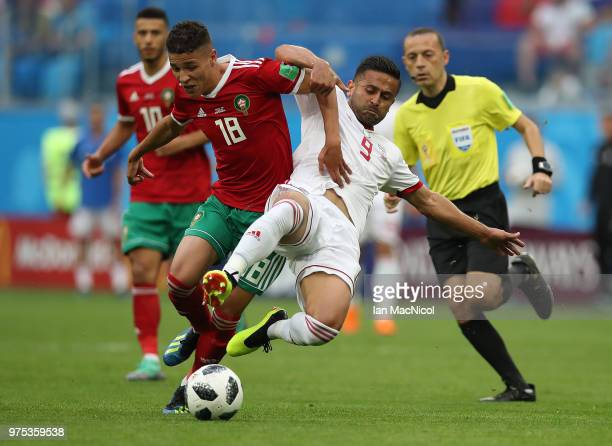 Amine Harit of Morocco is tackled by Omid Ebrahimi of Iran during the 2018 FIFA World Cup Russia group B match between Morocco and Iran at Saint...