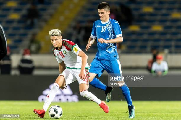 Amine Harit of Morocco Odil Xamrabekov of Uzbekistan during the international friendly match between Morocco and Uzbekistan at the Stade Mohammed V...