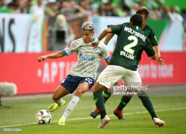 Amine Harit of Schalke 04 fights for the ball with William of Wolfsburg during the Bundesliga match between VfL Wolfsburg and FC Schalke 04 at...