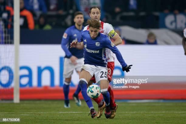 Amine Harit of Schalke 04 Matthias Lehmann of FC Koln during the German Bundesliga match between Schalke 04 v 1 FC Koln at the Veltins Arena on...