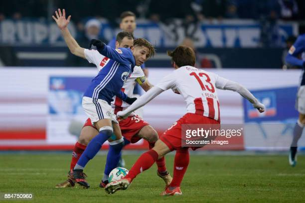 Amine Harit of Schalke 04 Matthias Lehmann of FC Koln Yuya Osako of FC Koln during the German Bundesliga match between Schalke 04 v 1 FC Koln at the...