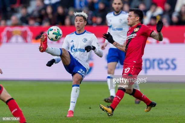 Amine Harit of Schalke and Charles Aranguiz of Leverkusen battle for the ball during the Bundesliga match between Bayer 04 Leverkusen and FC Schalke...