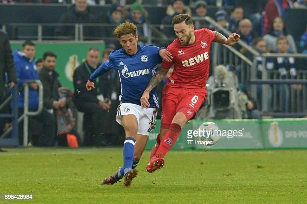 Amine Harit of Schalke and Marco Hoeger of Koeln battle for the ball during the Bundesliga match between FC Schalke 04 and 1 FC Koeln at VeltinsArena...