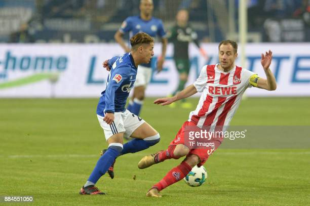 Amine Harit of Schalke and Matthias Lehmann of Koeln battle for the ball during the Bundesliga match between FC Schalke 04 and 1 FC Koeln Bundesliga...