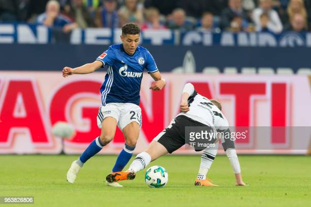 Amine Harit of Schalke and Mickael Cuisance of Moenchengladbach battle for the ball during the Bundesliga match between FC Schalke 04 and Borussia...