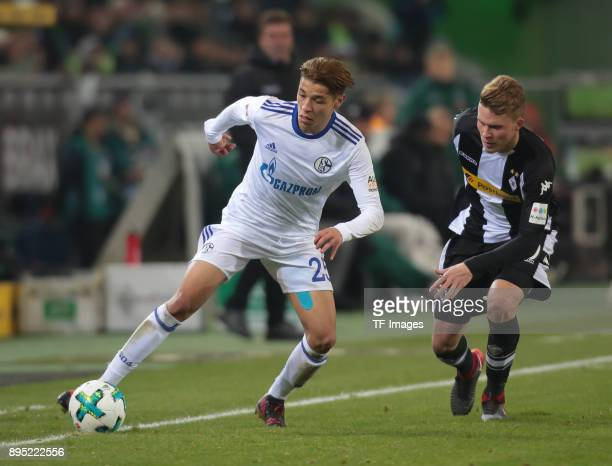 Amine Harit of Schalke and Nico Elvedi of Moenchengladbach battle for the ball during the Bundesliga match between Borussia Moenchengladbach and FC...