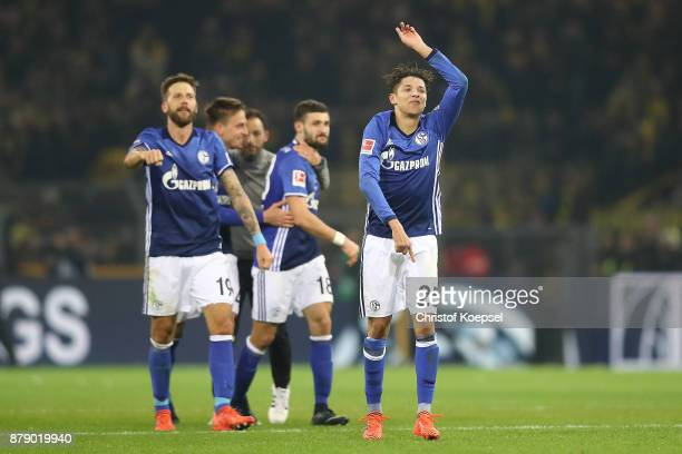 Amine Harit of Schalke and other players of Schalke celebrate after the Bundesliga match between Borussia Dortmund and FC Schalke 04 at Signal Iduna...