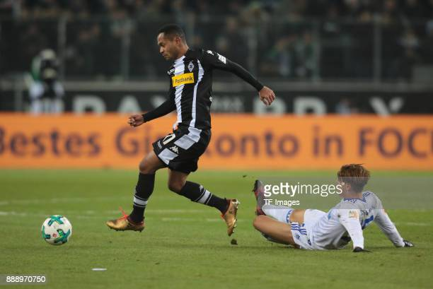 Amine Harit of Schalke and Raffael of Borussia Moenchengladbach battle for the ball during the Bundesliga match between Borussia Moenchengladbach and...