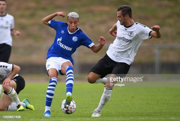 Amine Harit of Schalke and Robin Fechner of Schwarz Weiss Essen battle for the ball during the Friendly match between Schwarz Weiss Essen and FC...
