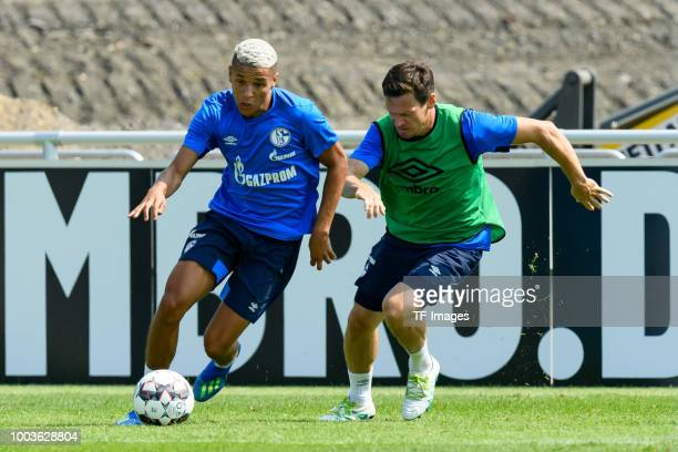 Amine Harit of Schalke and Sascha Riether of Schalke battle for the ball during a training session at the FC Schalke 04 Training center on July 19...