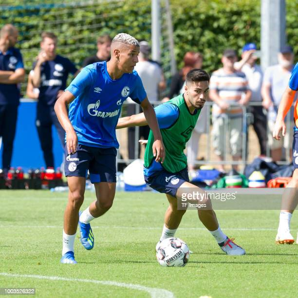 Amine Harit of Schalke and Suat Serdar of Schalke battle for the ball during a training session at the FC Schalke 04 Training center on July 18 2018...