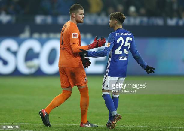 Amine Harit of Schalke argues with goalkeeper Timo Horn of Koeln after the Bundesliga match between FC Schalke 04 and 1 FC Koeln at VeltinsArena on...