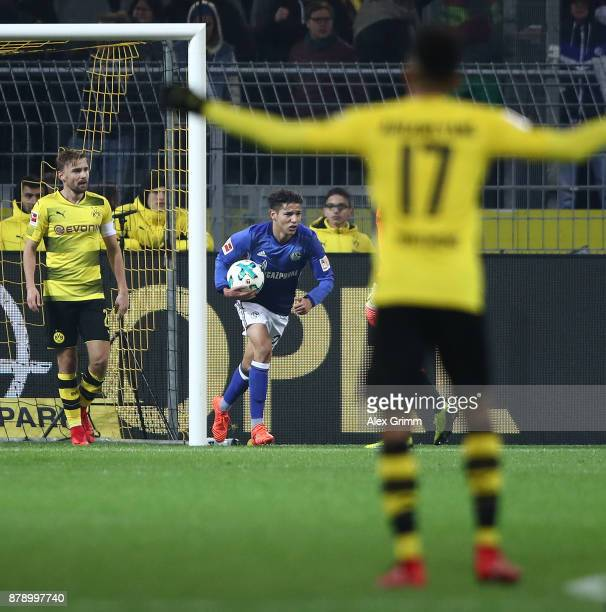 Amine Harit of Schalke carries the ball after he scored to make it 24 during the Bundesliga match between Borussia Dortmund and FC Schalke 04 at...