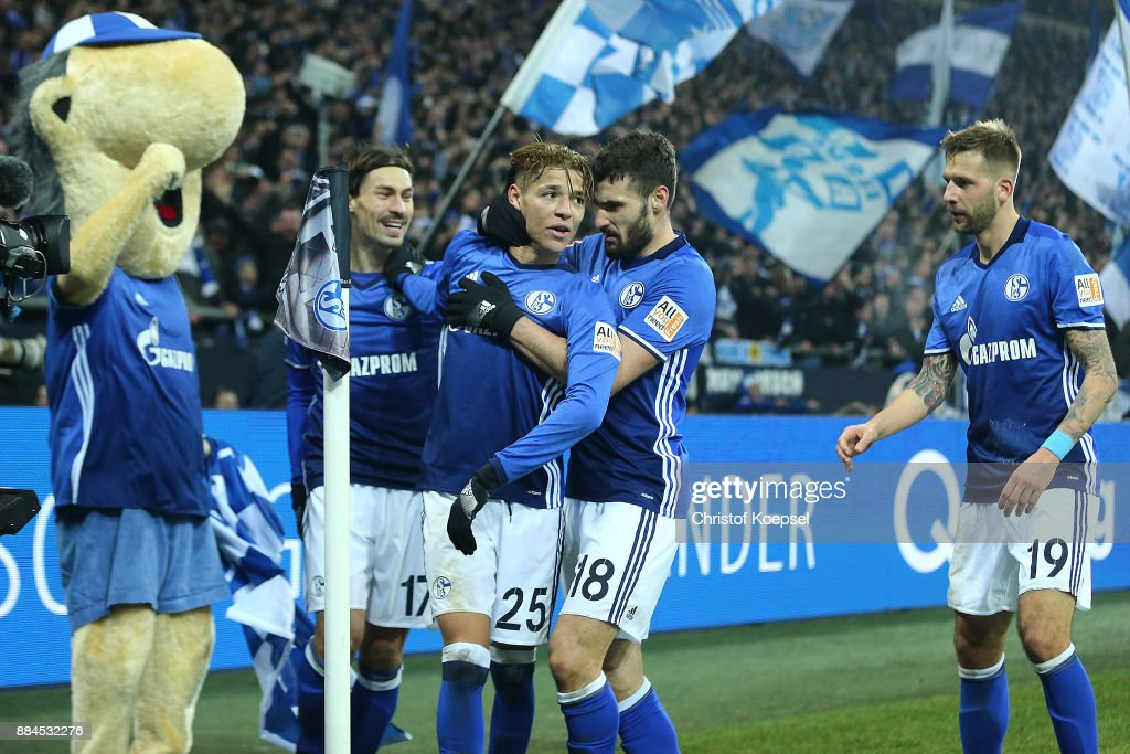 Amine Harit of Schalke (2nd left) celebrates after he scored a goal to make it 2:1 during the Bundesliga match between FC Schalke 04 and 1. FC Koeln at Veltins-Arena on December 2, 2017 in Gelsenkirchen, Germany.