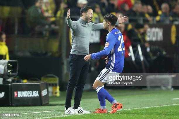 Amine Harit of Schalke celebrates after he scored to make it 20 with Coach Domenico Tedesco of Schalke during the Bundesliga match between Borussia...