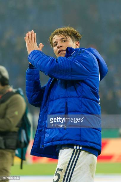 Amine Harit of Schalke celebrates after winning the DFB Cup match between FC Schalke 04 and 1 FC Koeln at VeltinsArena on December 19 2017 in...